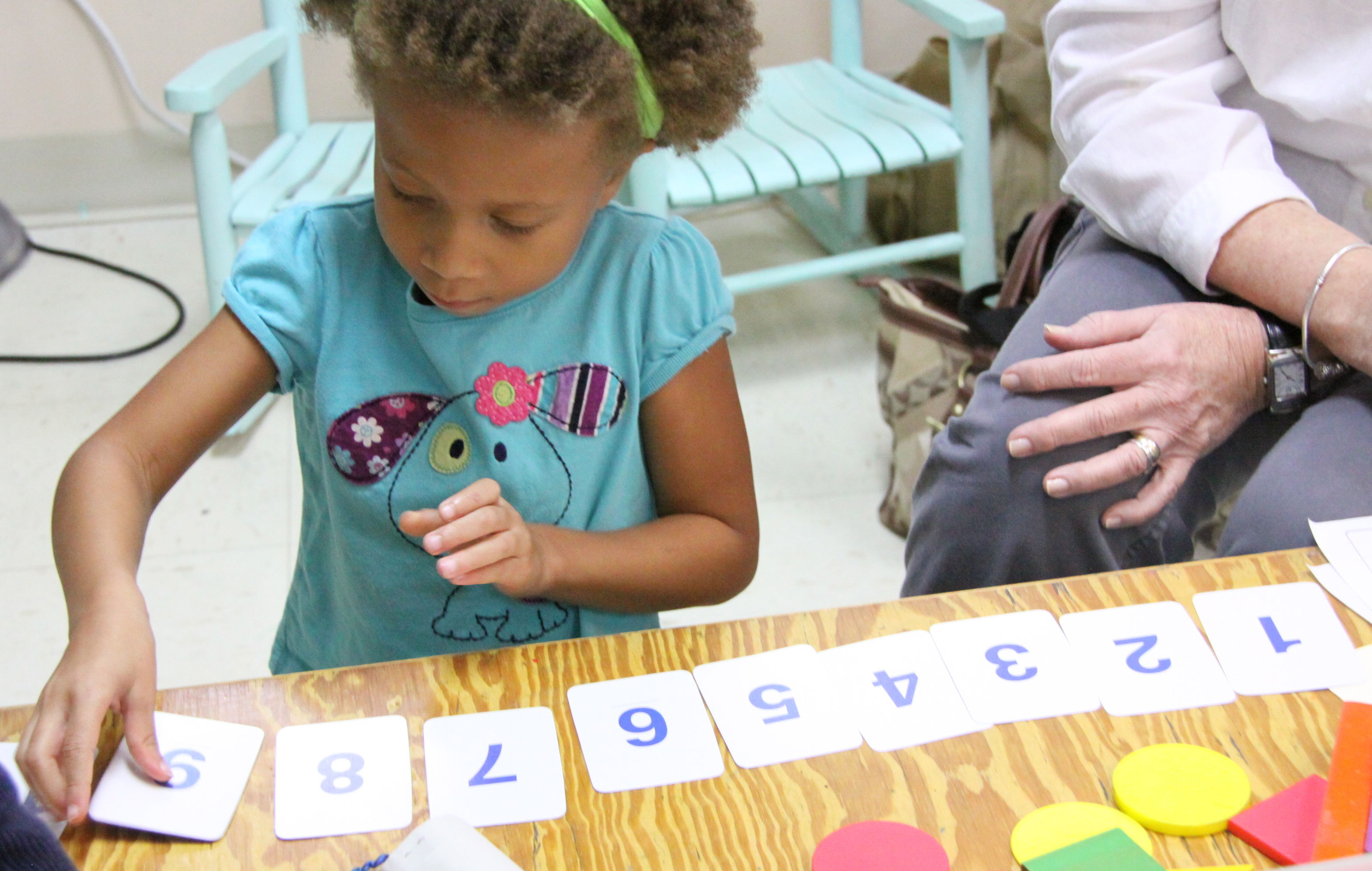 Kindergartener demonstrates her numeracy thinking during a one-on-one performance based assessment.